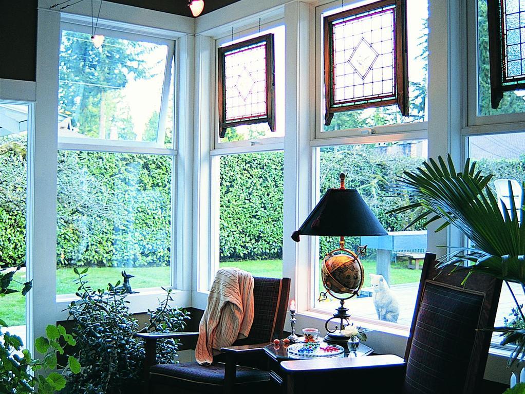 comment bien choisir les portes et fen tres de sa v randa. Black Bedroom Furniture Sets. Home Design Ideas