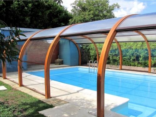 Abri de piscine fixe principe crit res de choix prix for Abri piscine prix
