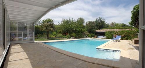 Abri de piscine en pvc ooreka for Abri piscine pvc