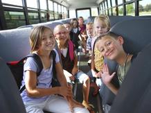enfants bus voyage sourires