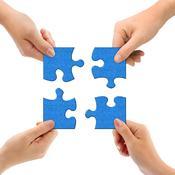 4 mains donnent un bout de puzzle