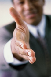Patron tend la main