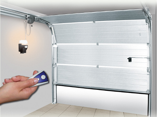 Automatisme d 39 une porte de garage ooreka for Assurer un garage