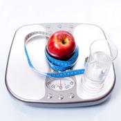 Balance, pomme et mètre à rouler